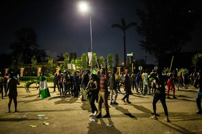 Witnesses said armed gunmen opened fire on a crowd of over 1,000 people to disperse them after a curfew was imposed to end spiralling protests over police brutality