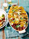 """<p>Load this nachos recipe up with toppings and deliver to the table for everyone to dig in. </p><p><strong>Recipe: <a href=""""https://www.goodhousekeeping.com/uk/food/recipes/a29207916/chilli-nachos/"""" rel=""""nofollow noopener"""" target=""""_blank"""" data-ylk=""""slk:Nacho Chilli Beef"""" class=""""link rapid-noclick-resp"""">Nacho Chilli Beef</a></strong></p>"""
