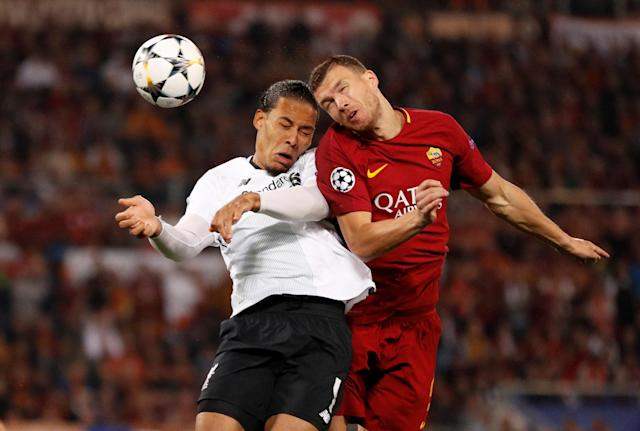 Soccer Football - Champions League Semi Final Second Leg - AS Roma v Liverpool - Stadio Olimpico, Rome, Italy - May 2, 2018 Roma's Edin Dzeko in action with Liverpool's Virgil van Dijk Action Images via Reuters/John Sibley