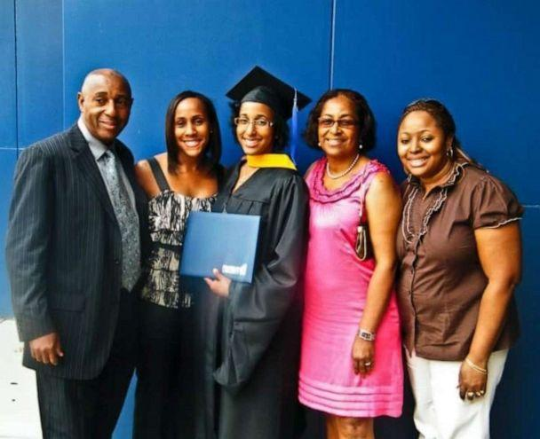 PHOTO: Jordanne Wells poses with her family after her graduation from Franklin University with a master's degree in 2010. (Cedric Wells)