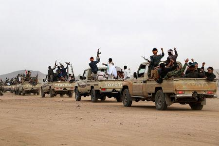 Houthi fighters ride on the back of trucks as they parade in the northwestern city of Saada, Yemen before they headed to the capital Sanaa August 23, 2017. REUTERS/Naif Rahma