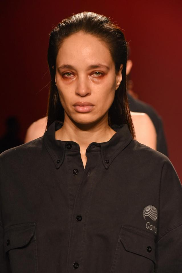 <p>A model in a button-down shirt and made to look like she'd been crying on the Willy Chavarria runway. (Photo: Getty Images) </p>