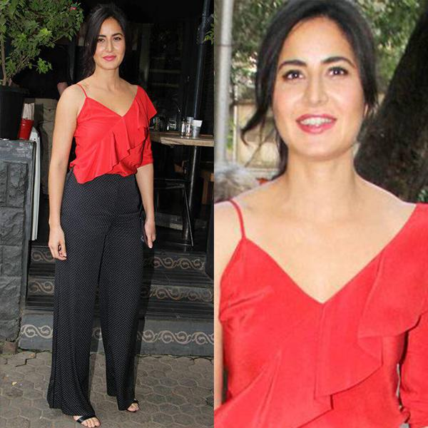 <p>Snapped spending some quality time with her family, Katrina wore a a red ruffled top with wide-legged pants, both from DvF. </p>