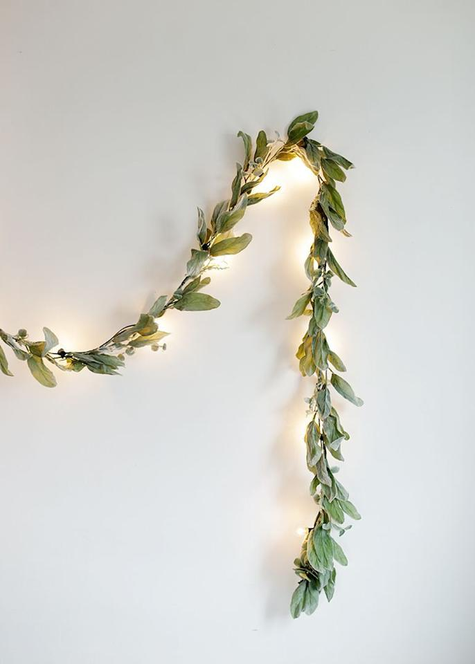"""<p>Give your engagement party a magical glow with this DIY globe light garland. Using artificial greenery means this garland will last forever and could even be used again on your wedding day.  </p><p><strong>Get the tutorial at <a href=""""https://themerrythought.com/diy/diy-greenery-globe-light-garland/"""" target=""""_blank"""">The Merry Thought</a>.</strong> </p><p><a class=""""body-btn-link"""" href=""""https://www.amazon.com/PARTY-JOY-Artificial-Eucalyptus-Greenery/dp/B07H321CMG/?tag=syn-yahoo-20&ascsubtag=%5Bartid%7C10050.g.31102641%5Bsrc%7Cyahoo-us"""" target=""""_blank"""">SHOP FAUX GREENERY GARLANDS</a></p>"""