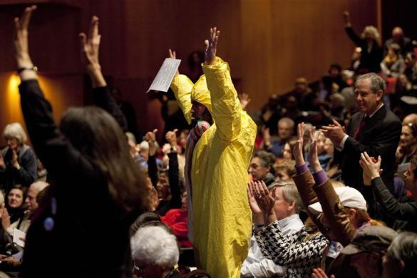 Abram Loeb (C) celebrates with other protesters after collectively reading a statement against hydraulic fracturing at the Tribeca Performing Arts Center, Borough of Manhattan Community College in New York November 30, 2011.