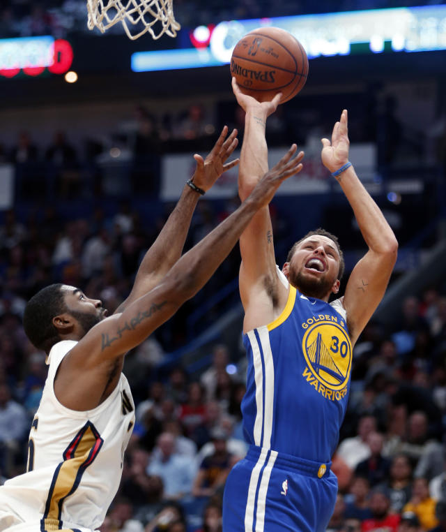 Golden State Warriors guard Stephen Curry (30) shoots over New Orleans Pelicans guard E'Twaun Moore in the first half of an NBA basketball game in New Orleans, Monday, Dec. 4, 2017. (AP Photo/Gerald Herbert)