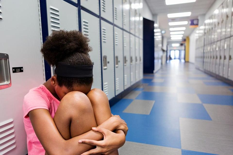<p>'My school experience oscillated between fleeting moments of belonging and the jarring reality of being othered'</p> (Getty Images)
