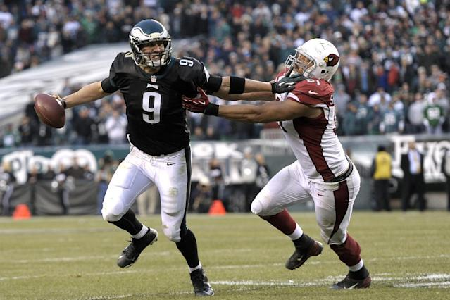 Philadelphia Eagles' Nick Foles, tries to break free from Arizona Cardinals' Matt Shaughnessy during the second half of an NFL football game, Sunday, Dec. 1, 2013, in Philadelphia. Philadelphia won 24-21. (AP Photo/Michael Perez)