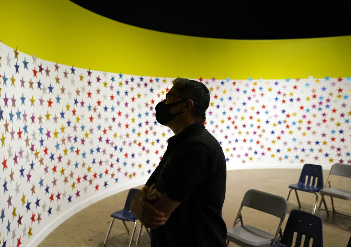 Secretary of the Department of Health and Human Services Xavier Becerra, looks at a wall of stars, one each for each child released, at an emergency shelter for migrant children Friday, July 2, 2021, in Pomona, Calif. The Biden administration on Friday gave a rare look inside the emergency shelter it opened to house migrant children crossing the U.S.-Mexico border alone, calling the California facility a model among its large-scale sites, some of which have been plagued by complaints. (AP Photo/Marcio Jose Sanchez, Pool)
