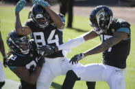 Jacksonville Jaguars wide receiver DJ Chark Jr., right, celebrates his touchdown reception against the Chicago Bears with teammates wide receiver Keelan Cole Sr. (84) and running back Dare Ogunbowale (33) during the first half of an NFL football game, Sunday, Dec. 27, 2020, in Jacksonville, Fla. (AP Photo/Phelan M. Ebenhack)
