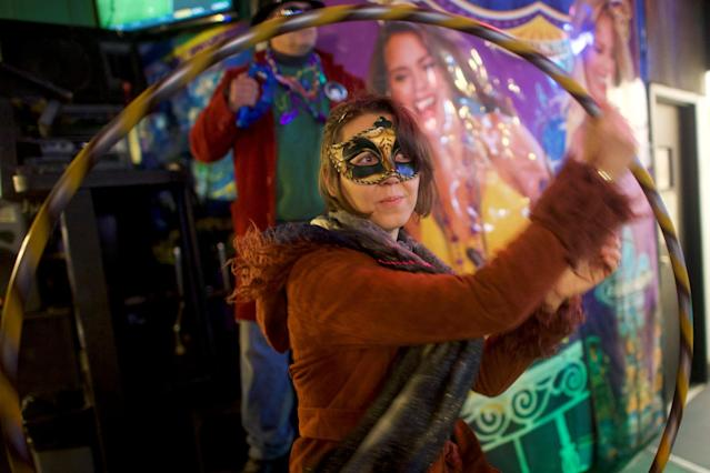 Jenny Kucharski dances with a hula hoop during a Mardi Gras themed party before the Philadelphia Eagles play with the New England Patriots in Super Bowl LII in Philadelphia, Pennsylvania, U.S., February 4, 2018. REUTERS/Mark Makela