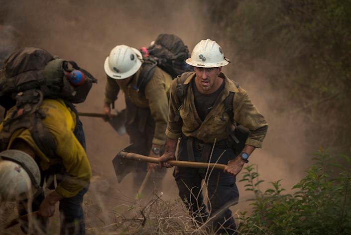 Hundreds of firefighters are still out battling the flame (Photo: David McNew via Getty Images)
