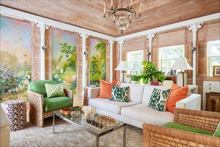 """<div class=""""caption""""> The sitting room's wood paneling and murals are original to the house. </div>"""
