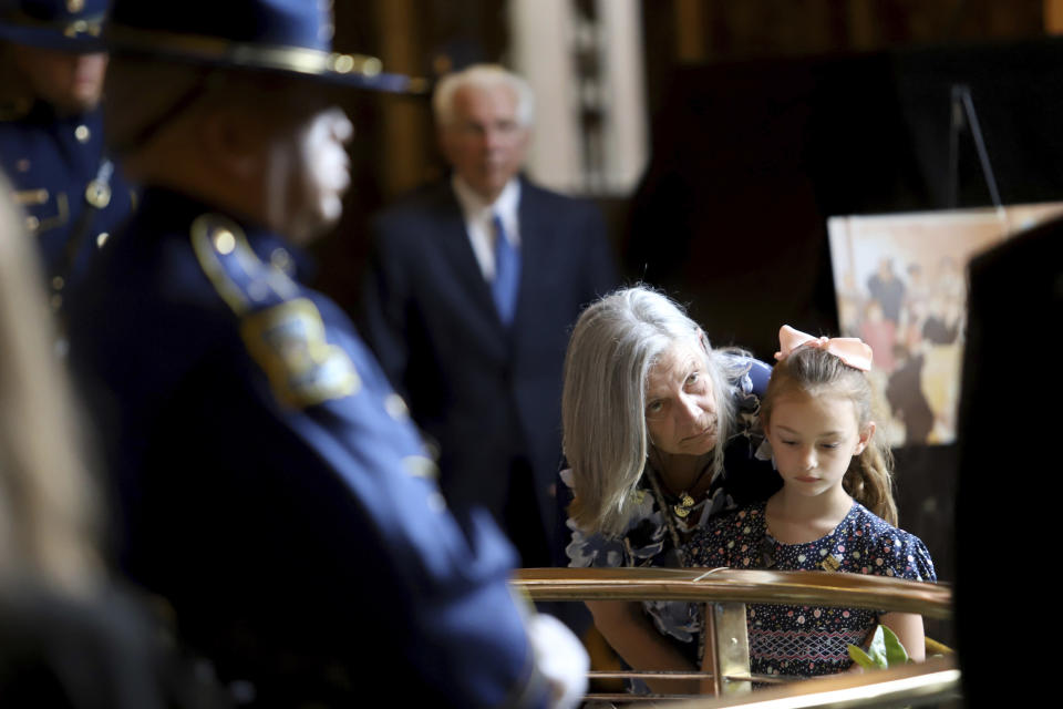 Edwin W. Edwards' daughter Anna and his great granddaughter Zoe, 6, view the casket as the former Louisiana Governor lies in state in Memorial Hall of the Louisiana State Capitol in Baton Rouge, La., Saturday, July 17, 2021. The colorful and controversial four-term governor died of a respiratory illness on Monday, July 12. (AP Photo/Michael DeMocker)