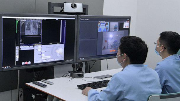PHOTO: Doctors use 5G technology to diagnose COVID-19 patients on Feb. 27, 2020, at West China Hospital of Sichuan University, in Chengdu, Sichuan, China. Li Zhenlin, Deputy Director of the Radiology Department, has remotely diagnosed 17 patients so far. (China News Service/Visual China Group via Getty Images, FILE)