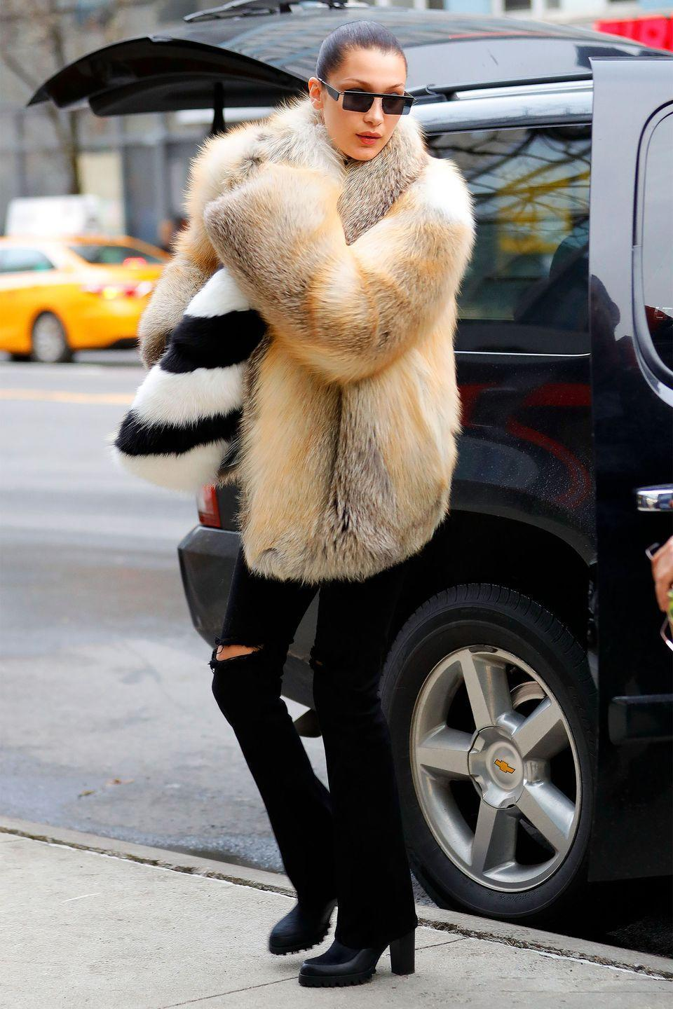 <p>In a Off-White fur coat with black flared jeans, Sol Sana heeled Chelsea boots and Adam Selman x Le Specs sunglasses while out in New York City. </p>