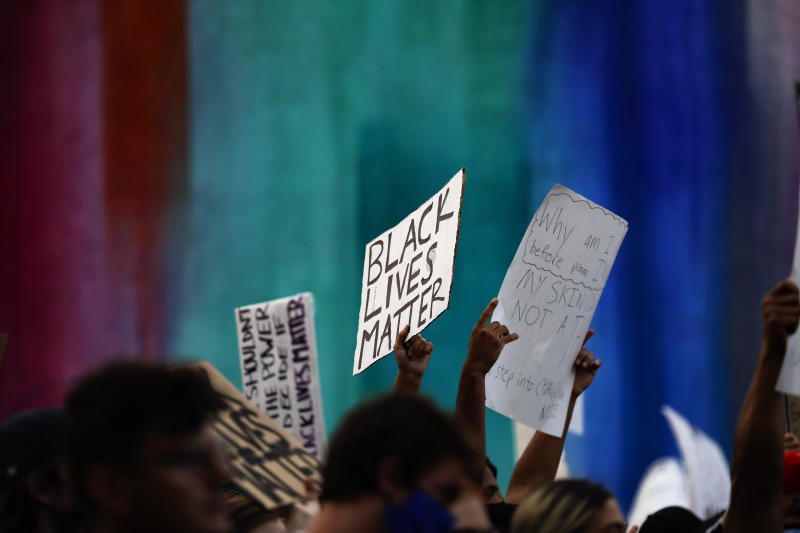 Protesters march Thursday, June 4, 2020, in San Diego over the death of George Floyd, a black man who died after being restrained by Minneapolis police officers on May 25. (AP Photo/Gregory Bull)