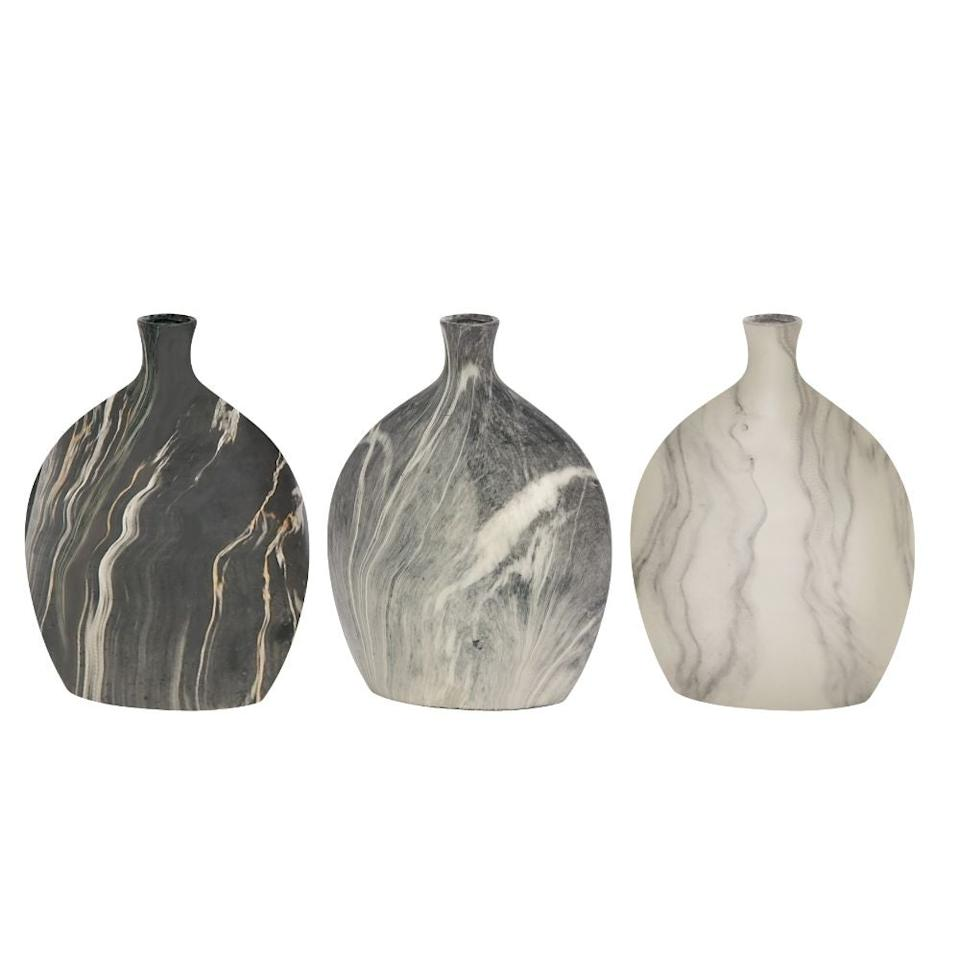"Use any of these three assorted vases to add texture and boldness to any setup.<br><br><strong><em><a href=""https://www.walmart.com/search?query=benzara&redirect=false"" rel=""nofollow noopener"" target=""_blank"" data-ylk=""slk:Shop Walmart"" class=""link rapid-noclick-resp"">Shop Walmart</a></em></strong> <br><br><strong>Benzara</strong> Classy Ceramic Vase, $, available at <a href=""https://go.skimresources.com/?id=30283X879131&url=https%3A%2F%2Fwww.walmart.com%2Fip%2FClassy-Ceramic-Vase-Assorted-3%2F54740083%3F"" rel=""nofollow noopener"" target=""_blank"" data-ylk=""slk:Walmart"" class=""link rapid-noclick-resp"">Walmart</a>"