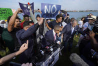 James Craig, a former Detroit Police Chief, leaves after announcing he is a Republican candidate for Governor of Michigan amongst protesters on Belle Isle in Detroit, Tuesday, Sept. 14, 2021. (AP Photo/Paul Sancya)