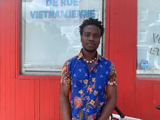 Prodil Houanhou says he was violently handcuffed and ticketed by Montreal police after stopping to observe the potential arrest of another Black man.  (Chloe Ranaldi/CBC - image credit)
