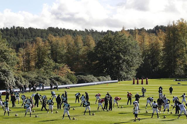 Jacksonville Jaguars' players warm-up during their football practice at the Pennyhill Park Hotel and Spa in Bagshot, England, Wednesday, Oct. 23, 2013. The Jaguars face the San Francisco 49ers on Sunday in a NFL football game at Wembley Stadium in London. (AP Photo/Sang Tan)
