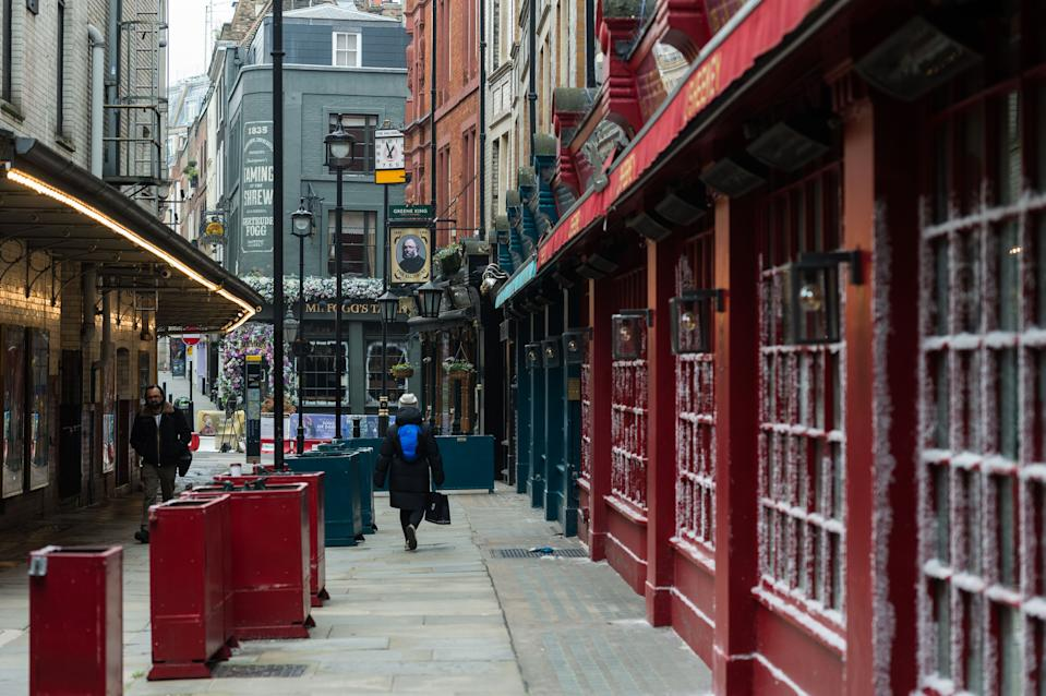 LONDON, UNITED KINGDOM - MARCH 02, 2021: People walk past a closed pub in central London as England remains under third lockdown to reduce the number of Covid-19 infections, on 02 March, 2021 in London, England. Chancellor Rishi Sunak is due to announce his tax and spending plans in 2021 Budget tomorrow with the main focus on measures to support the UK's economic recovery from the slump caused by the coronavirus pandemic including a £5bn scheme for High Street shops and hospitality businesses as well as £408m for museums, theatres and galleries.- PHOTOGRAPH BY Wiktor Szymanowicz / Barcroft Studios / Future Publishing (Photo credit should read Wiktor Szymanowicz/Barcroft Media via Getty Images)