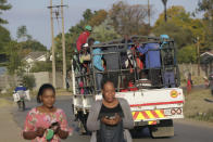 A truck loaded with people travels on a street, in Harare, Tuesday, July, 6, 2021. Zimbabwe has reactivated strict lockdown measures it once imposed when COVID-19 first hit the country last year, as the country battles a resurgence of the virus amid vaccine shortages. (AP Photo/Tsvangirayi Mukwazhi)