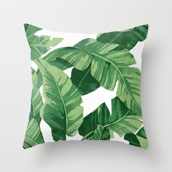 <p>Switch out your old pillow for this bold <span>Society6 Tropical Banana Leaves IV Throw Pillow</span> ($24, originally $30).</p>