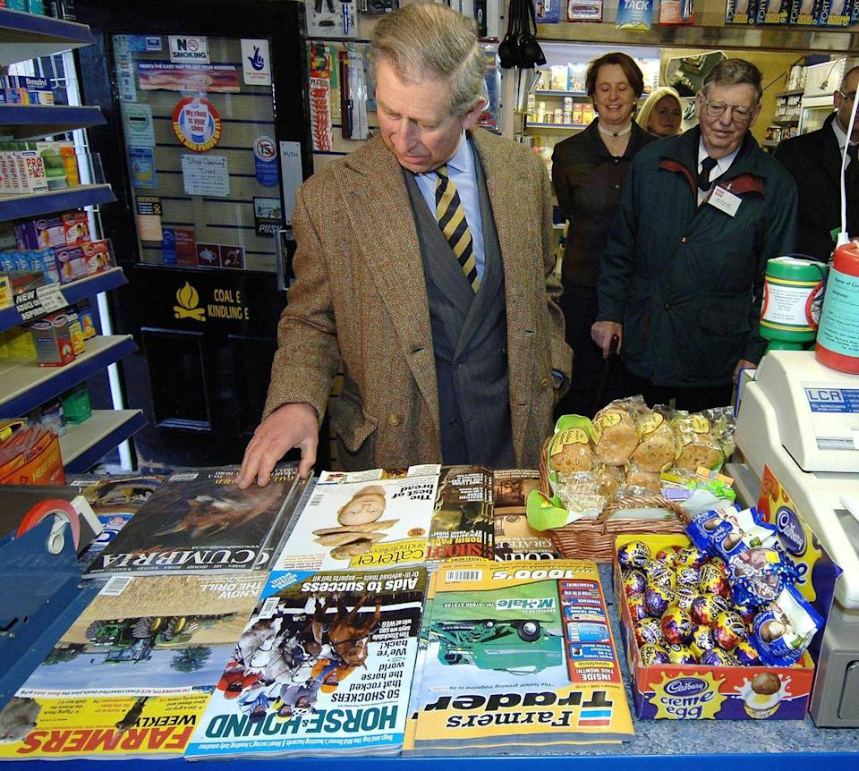 <p>Something catch your eye, Charles? The Prince stopped for a moment to examine the magazine stand at a post office in Cumbria, England. He's just like us and can't resist the goodies in the checkout line. </p>