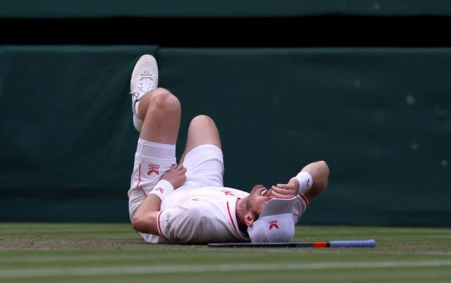 Andy Murray looked in pain after slipping over in the fourth set