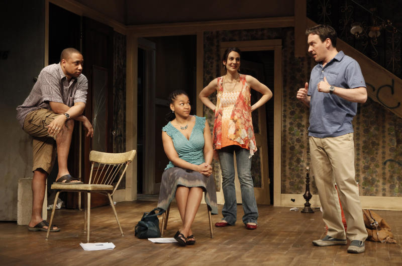 "FILE - In this theater publicity file photo released by The Publicity Office, from left, Damon Gupton, Crystal A. Dickinson, Annie Parisse and Jeremy Shamos are shown in a scene from Bruce Norris' ""Clybourne Park,"" at Playwrights Horizons in New York. The Pulitzer Prize-winning playwright of ""Clybourne Park,"" says he withdrew permission for a Berlin theater company to produce the play after learning that one of the actors would perform the roles in blackface. (AP Photo/The Publicity Office, Joan Marcus, File)"