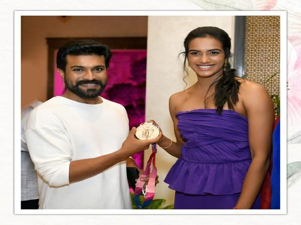 Ram Charan with PV Sindhu at the event