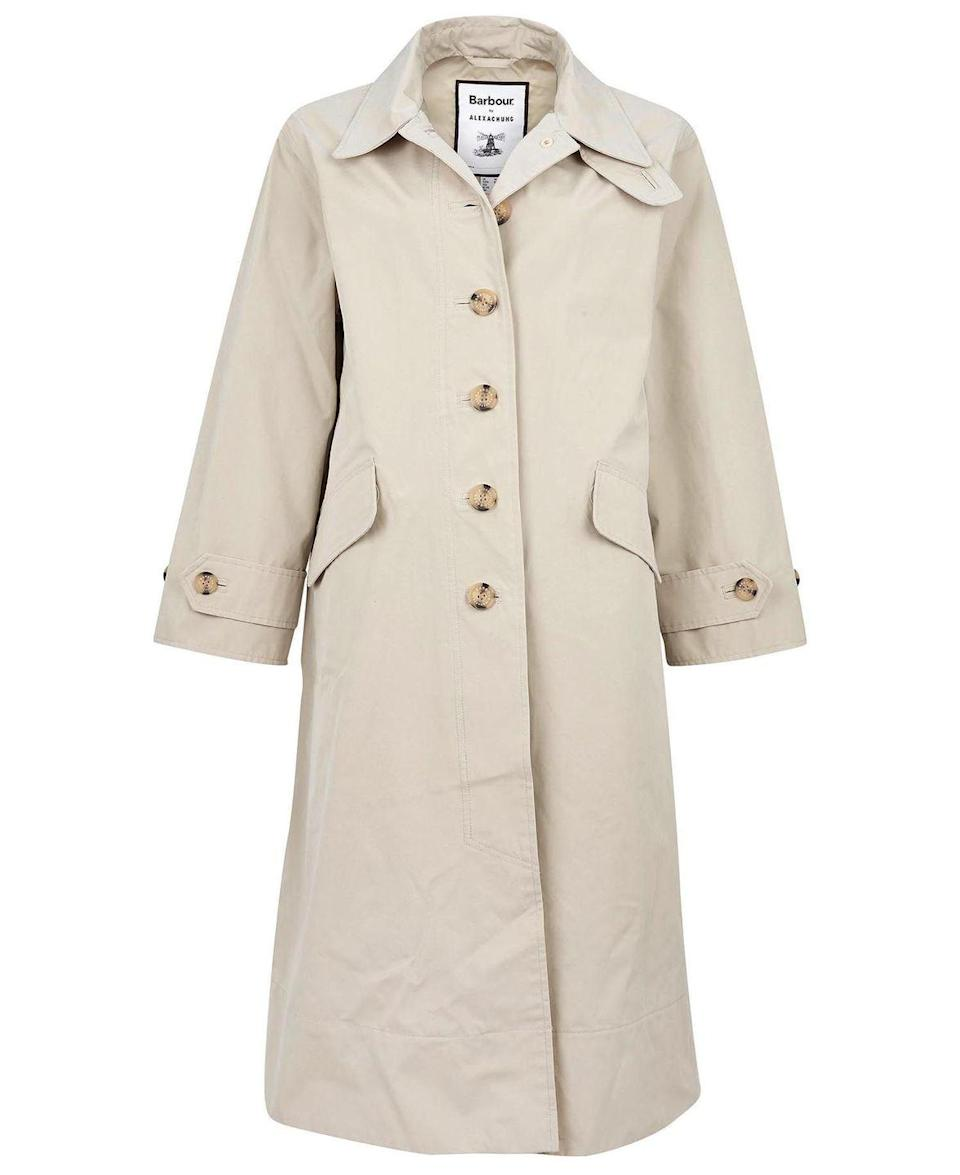 """<p><a class=""""link rapid-noclick-resp"""" href=""""https://www.barbour.com/uk/barbour-by-alexachung-julie-waterproof-jacket"""" rel=""""nofollow noopener"""" target=""""_blank"""" data-ylk=""""slk:SHOP NOW"""">SHOP NOW</a></p><p>A classic silhouette, Alexa Chung's Barbour design comes in both mist and navy and features minimal pared-back detailing including a tie-waist, a button front fastening and a wear-two-ways collar design.</p><p>Julie waterproof jacket, £299, <a href=""""https://www.barbour.com/uk/barbour-by-alexachung-julie-waterproof-jacket"""" rel=""""nofollow noopener"""" target=""""_blank"""" data-ylk=""""slk:Barbour"""" class=""""link rapid-noclick-resp"""">Barbour</a> by ALEXACHUNG</p>"""