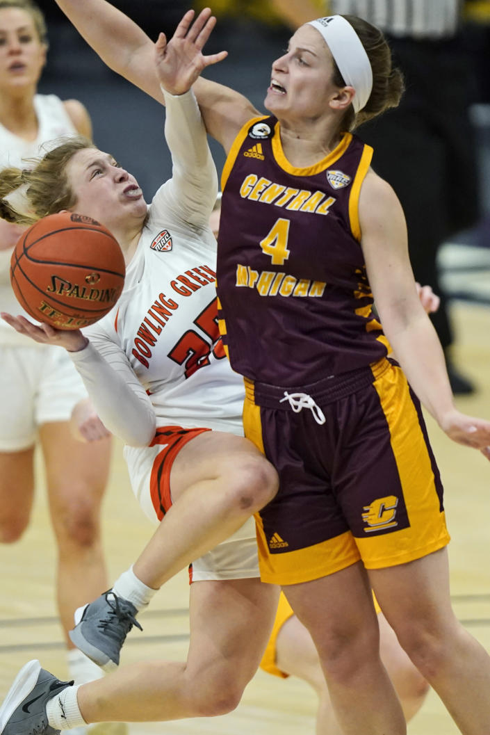 Bowling Green's Lexi Fleming (25) is stopped by Central Michigan's Maddy Watters (4) during the second half of an NCAA college basketball game in the championship of the Mid-American Conference tournament, Saturday, March 13, 2021, in Cleveland. Central Michigan won 77-72. (AP Photo/Tony Dejak)