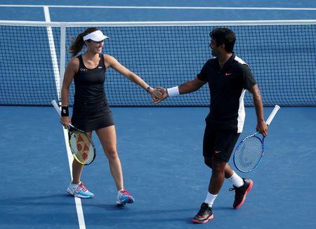Martina Hingis of Switzerland celebrates a point with mixed doubles partner Leander Paes of India during their finals match against Bethanie Mattek-Sands and Sam Querrey of the U.S. at the U.S. Open Championships tennis tournament in New York, September 11, 2015. REUTERS/Shannon Stapleton Picture Supplied by Action Images