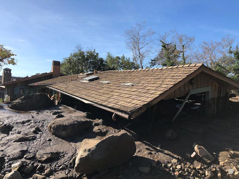 A damaged Montecito house is surrounded bydislodged boulders and debris. (Mike Eliason/Santa Barbara County Fire Department via Reuters)