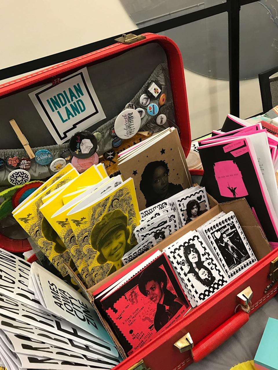 A collection of zines by Marya Errin Jones are arranged in a case. Jones, founder of the ABQ Zine Fest, said she's often one of the only Black women at some zine festivals and events.