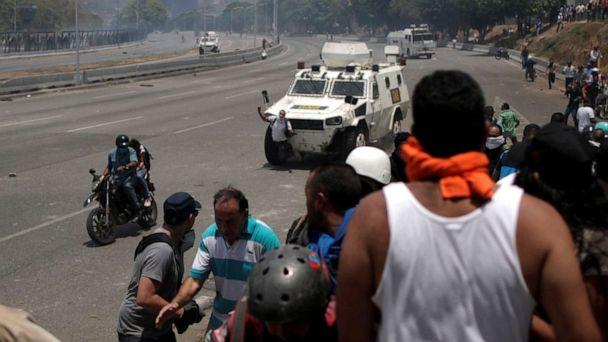 PHOTO: An opposition demonstrator is struck by a Venezuelan National Guard vehicle on a street near the Generalisimo Francisco de Miranda Airbase 'La Carlota' in Caracas, Venezuela, April 30, 2019. (Ueslei Marcelino/Reuters)
