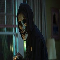 image of a person most likely a villian wearing a skull mask