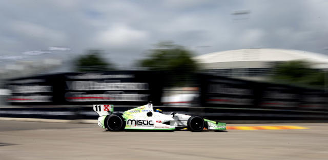 Sebastien Bourdais, of France, makes his way through Turn 3 during a practice session for the IndyCar Grand Prix of Houston auto race Friday, June 27, 2014, in Houston. (AP Photo/David J. Phillip)