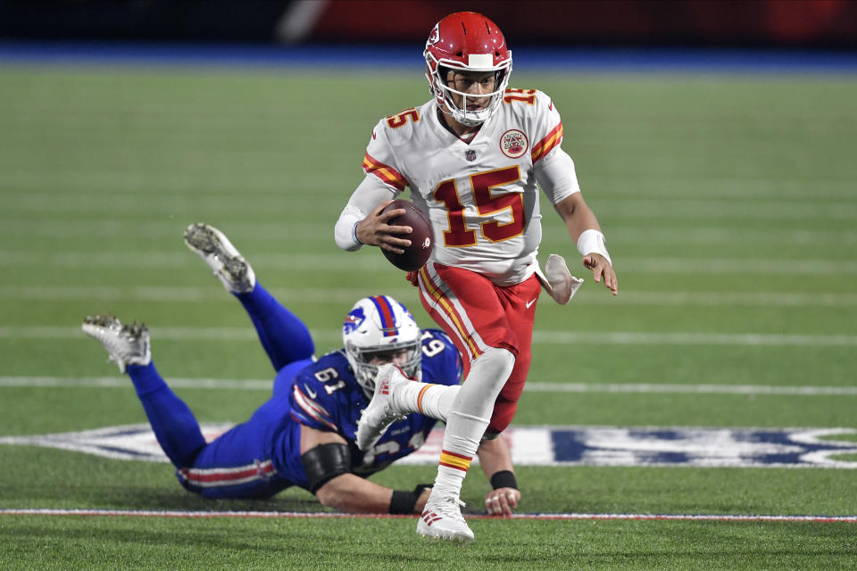 Kansas City Chiefs quarterback Patrick Mahomes (15) evades Buffalo Bills' Justin Zimmer during the second half of an NFL football game, Monday, Oct. 19, 2020, in Orchard Park, N.Y. (AP Photo/Adrian Kraus)