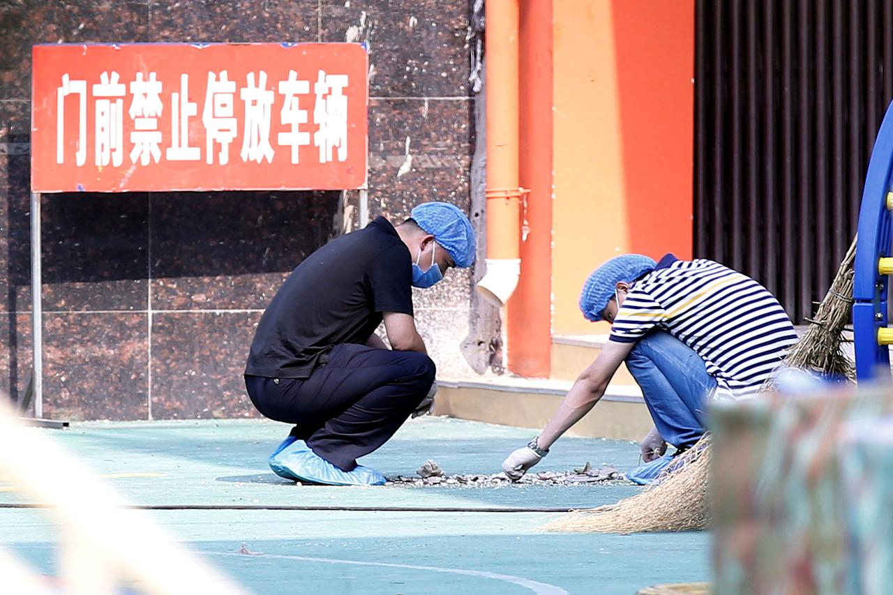 <p>Investigators work at the scene of an explosion inside a kindergarten in Fengxian County in Jiangsu Province, China, June 16, 2017. (Photo: Aly Song/Reuters) </p>