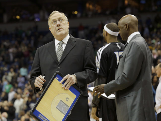 Minnesota Timberwolves head coach Rick Adelman checks the scoreboard during a timeout in the fourth quarter of an NBA basketball game against the Utah Jazz in Minneapolis, Wednesday, April 16, 2014. The Jazz won 136-130 in double overtime. (AP Photo/Ann Heisenfelt)