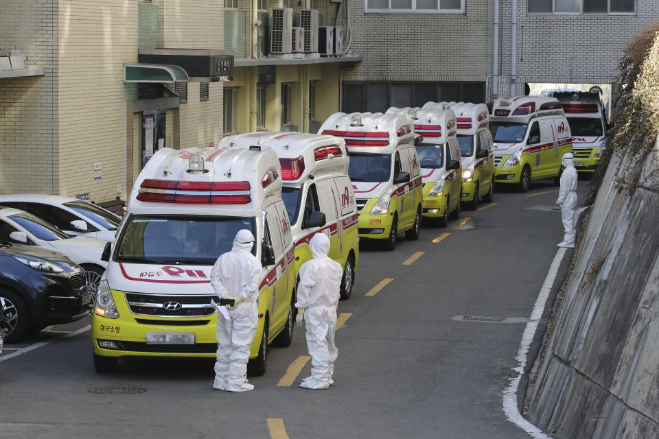 """Ambulances carrying patients infected with the novel coronavirus arrive at a hospital in Daegu, South Korea, Sunday, Feb. 23, 2020. South Korea's president has put the country on its highest alert for infectious diseases and says officials should take """"unprecedented, powerful"""" steps to fight a viral outbreak.(Lim Hwa-young/Yonhap via AP)"""