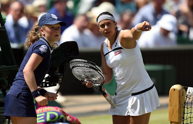 France's Marion Bartoli points something out to a ballgirl during her match against Germany's Sabine Lisicki during day twelve of the Wimbledon Championships at The All England Lawn Tennis and Croquet Club, Wimbledon.