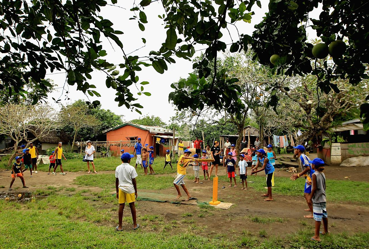 PORT VILA, VANUATU - MAY 16:  Local children play cricket during an ICC Cricket Development Program Clinic in Mele Village on May 16, 2012 in Port Vila, Vanuatu.  (Photo by Hamish Blair/Getty Images)
