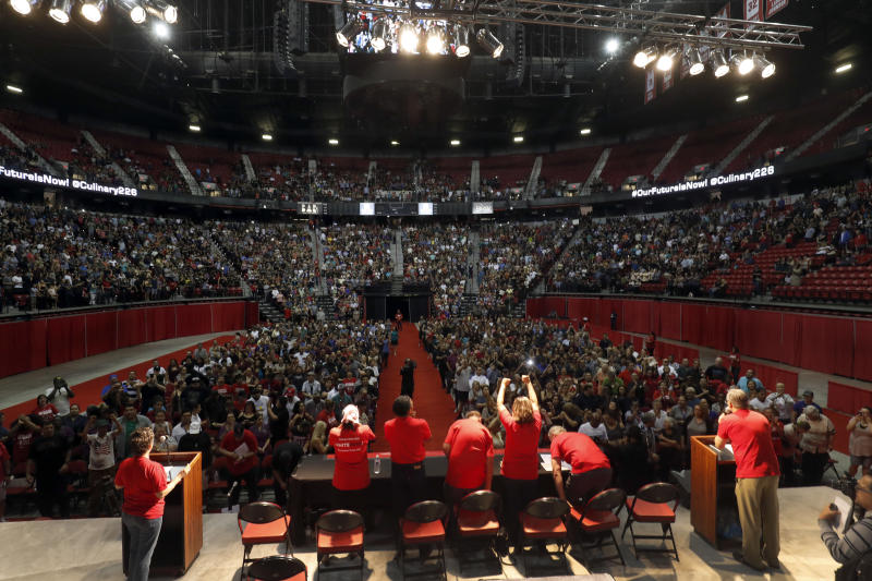 <p> FILE - In this May 22, 2018, file photo, members of the Culinary Workers Union, Local 226, assemble for a presentation at a university arena before an evening vote on whether to authorize a strike in Las Vegas. The two largest resort operators in Las Vegas would lose more than $10 million a day combined if housekeepers, cooks and others go on strike, a possibility starting Friday, the union representing thousands of casino workers said, Thursday, May 31, 2018. (Steve Marcus/Las Vegas Sun via AP, File) </p>