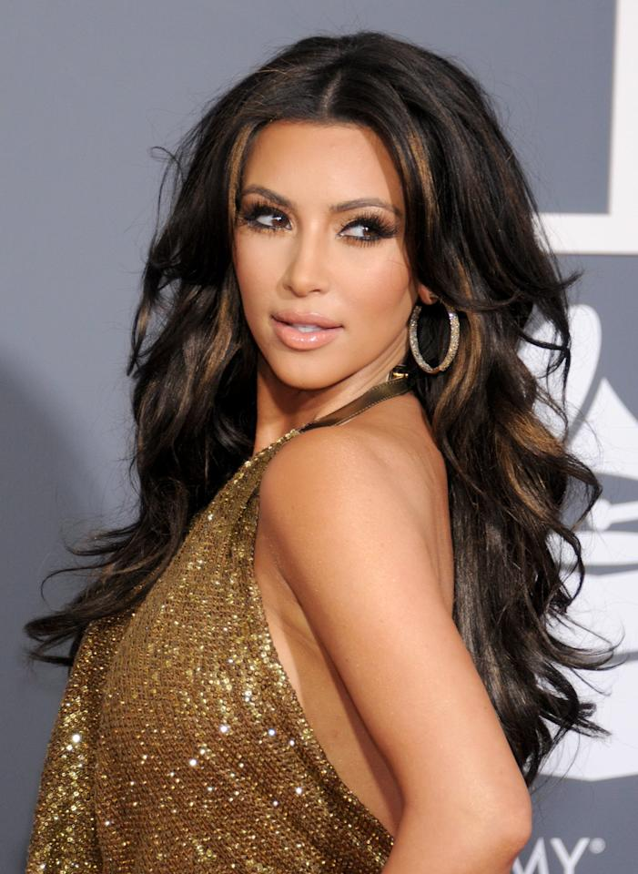 <p>Kardashian's caramel highlights and voluninous waves heated up the Grammys red carpet in 2011.</p>