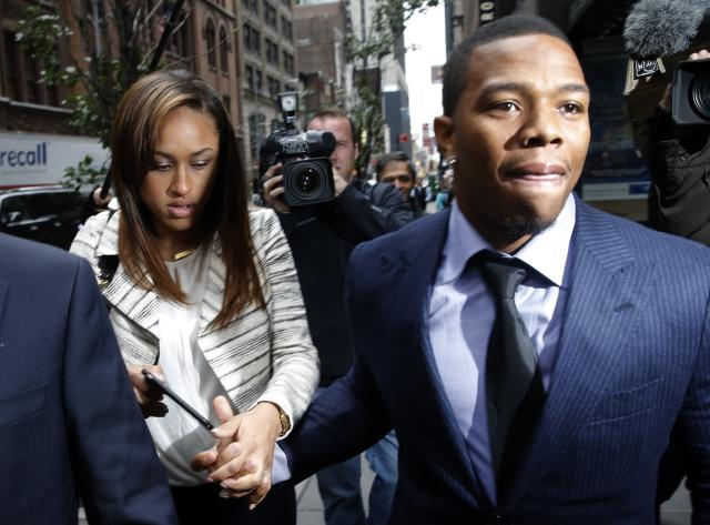 Former Baltimore Ravens NFL running back Ray Rice and his wife Janay arrive for a hearing at a New York City office building November 5, 2014. Rice is making his case on Wednesday to return to the field after the National Football League indefinitely suspended him from the game for claims of domestic violence. Rice, 27, claims that he was punished twice for the same offense, a one-punch knockout of his then-fiancee Janay Palmer during a February altercation at an Atlantic City, New Jersey, casino. REUTERS/Mike Segar (UNITED STATES - Tags: SPORT CRIME LAW FOOTBALL)