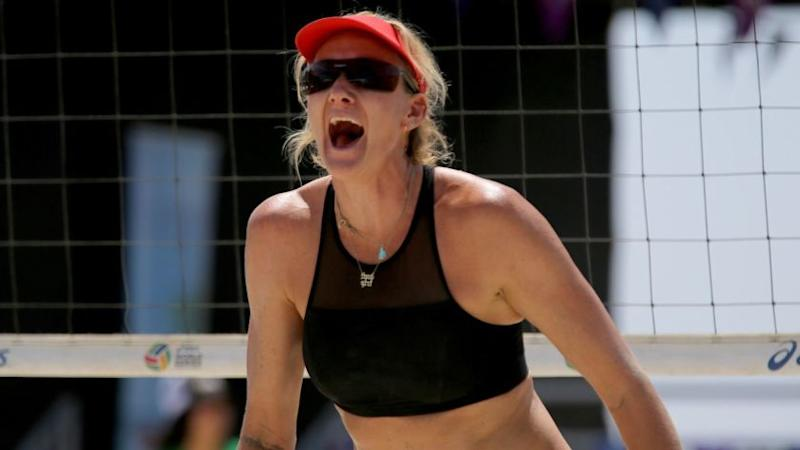 LONG BEACH, CALIF. -- THURSDAY, JULY 13, 2017: Kerri Walsh Jennings celebrates a point with partner Nicole Branagh, but the two were defeated by April Ross and Lauren Fendrick (shown at right) Thursday during the Long Beach Presidents Cup in The World Series of Beach Volleyball in Long Beach July 13, 2017. Former partners Kerri Walsh Jennings and April Ross faced each other for the first time in nearly four years. The event kicked off Thursday, and will run through the weekend in Long Beach. Some of the best of the sport will compete for the ultimate title in Long Beach, Calif., on July 13, 2017. (Allen J. Schaben / Los Angeles Times)